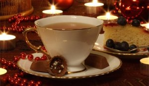 tea cup and holiday chocolates